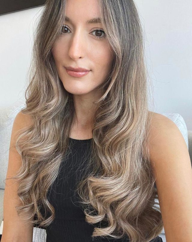 Blonde balayage hair colour modelled by woman